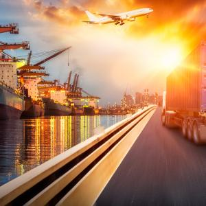 Composite Cranes, Ships, Water, Road, Trucks, Orange Sky AdobeStock_258838496.jpeg