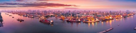 Panorama Two Waterways Many Ships Docks Cranes Distant City AdobeStock_268598603.jpeg